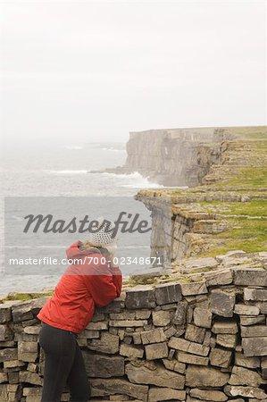 Woman at Dun Aengus Fort, Inishmor, Aran Islands, County Galway, Ireland