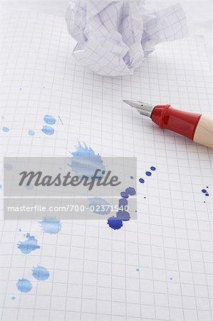 Leaking Pen Leaving Ink Spots on Paper