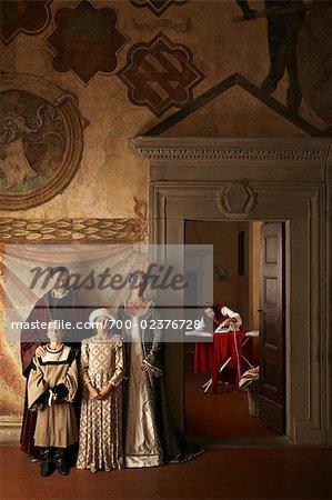 Maid Ironing and Medieval Family, Mugello, Tuscany, Italy