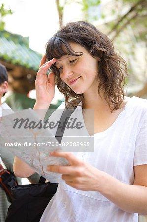 Woman Smiling at Map, China Town, San Francisco, California, USA
