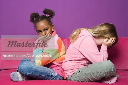 Upset Girls on Sofa