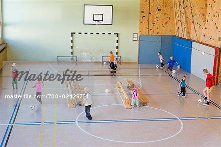 Kids Playing Soccer in Gymnasium, Salzburger Land, Austria