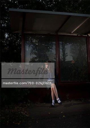 Girl Waiting at Bus Stop at Night