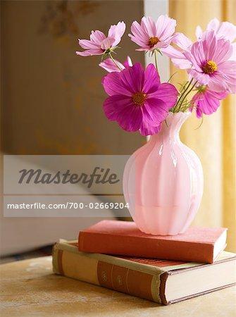 Purple Flowers In Vase On Bedside Table   Stock Photo
