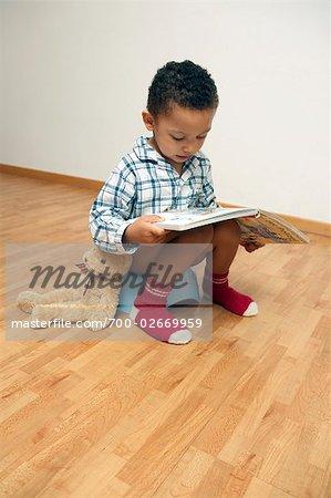 Boy Reading Book on Potty