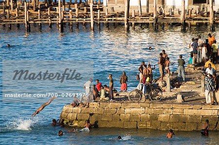 People Jumping into Water, Zanzibar, Tanzania