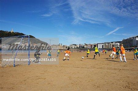 Youth Soccer Game on the Beach, San Sebastian, Basque Country, Spain