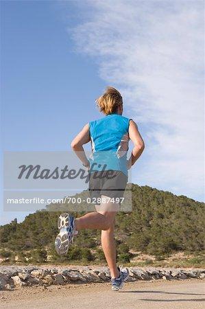Man Jogging at Beach, Ibiza, Spain