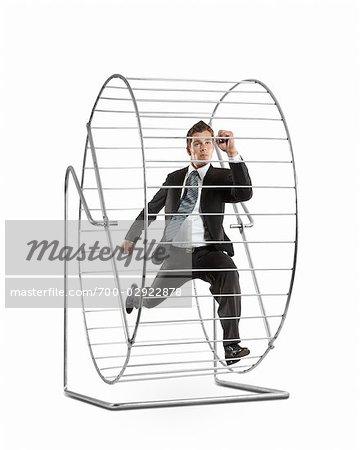 Businessman Running on a Hamster Wheel