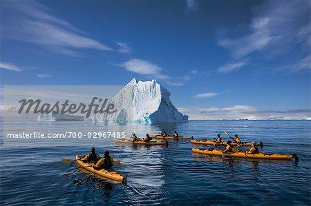 People Kayaking near Iceberg, Antarctica