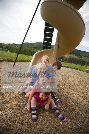Children at Bottom of Slide