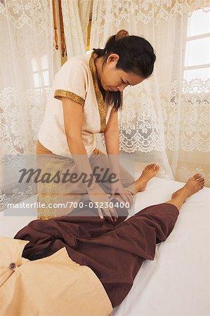 Woman performing Thai Massage, Bangkok, Thailand