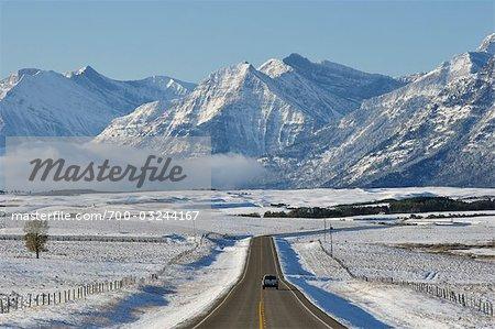 Road and Rocky Mountains Near Waterton Lakes, Alberta, Canada