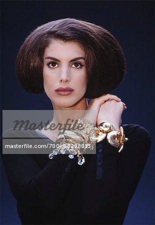5513c70ef Portrait of Woman in Formal Wear and Showing Bracelets - Stock Photo