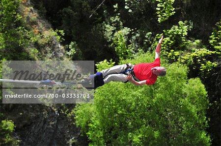 Man Bungee Jumping off Kawarau Suspension Bridge near Queenstown, South Island, New Zealand