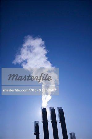 Silhouette of Smoke Stacks