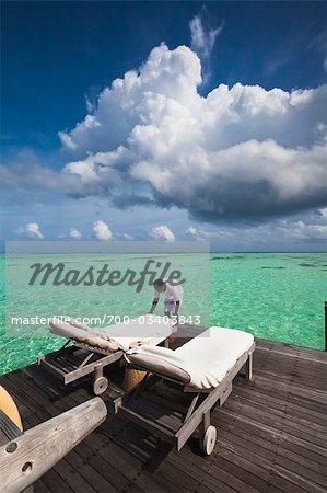 Hotel Staff Preparing Lounge Chairs on Wharf, Soneva Gili Resort, Lankanfushi Island, North Male Atoll, Maldives