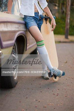 Woman Holding Skateboard, Portland, Oregon, USA