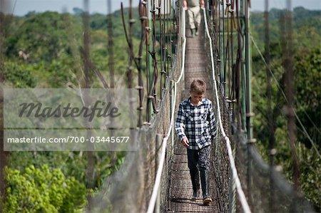 Boy on Footbridge, Sacha Lodge, Quito, Ecuador