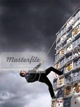 Businessman Climbing House of Cards