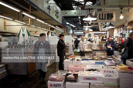 People Working at Tsukiji Central Wholesale Market, Tokyo, Japan