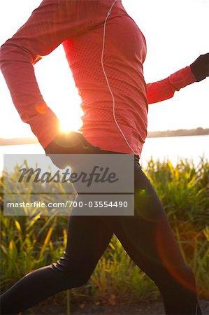 Woman Running at Sunset in Green Lake Park, Seattle, Washington, USA