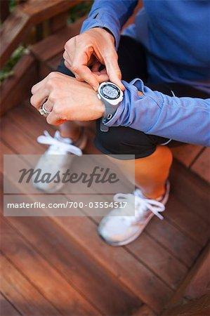 Woman Setting Timer on Watch