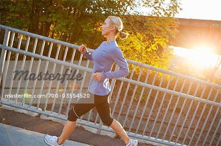 Woman Running at Sunset, Seattle, Washington, USA