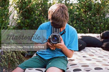 Teenage Boy Taking Pictures, Newport Beach, Orange County, USA
