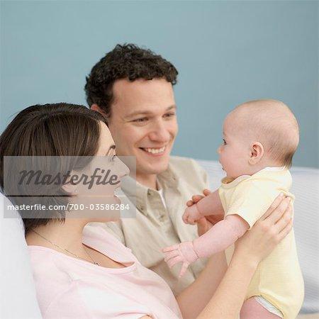 Happy Parents With Baby