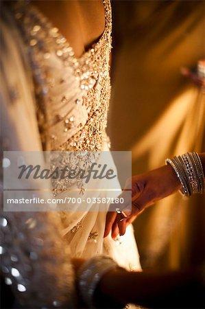 Hands Pinning Bride's Dress