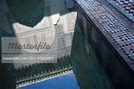 Reflection of Sahrij Madrasah in Water, Fez, Morocco