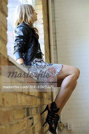 Woman Sitting on Window Ledge