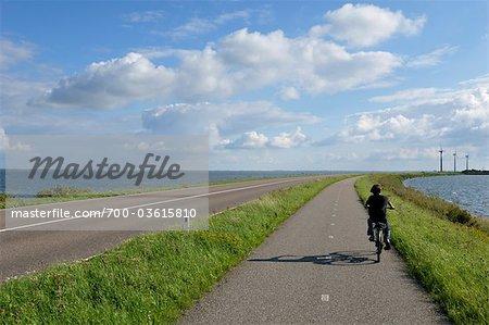 Boy Riding Bicycle on Bike Path, Amsterdam, Netherlands