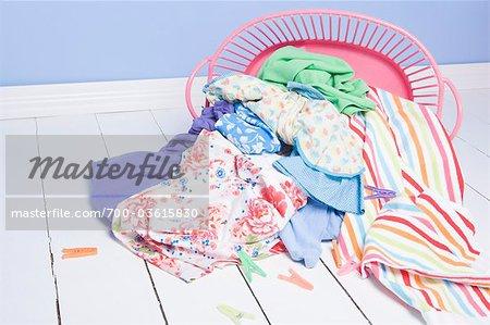Basket of Laundry Spilled onto Floor