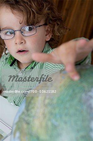 Little Boy Looking at Globe
