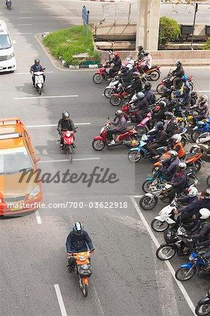 Crowd of Motorcycles Waiting at Red Light, Bangkok, Thailand