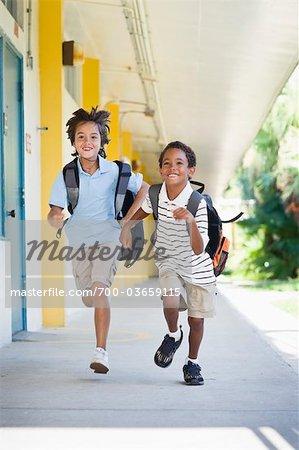 Boys Running at School