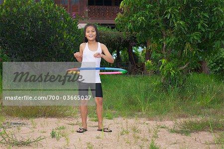 Young Girl Hula-hooping, Ubon Ratchatani, Ubon Ratchathani Province, Thailand