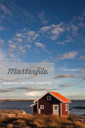 Red Wooden Hut on Shoreline, Bohuslaen, Vastra Gotaland County, Gotaland, Sweden