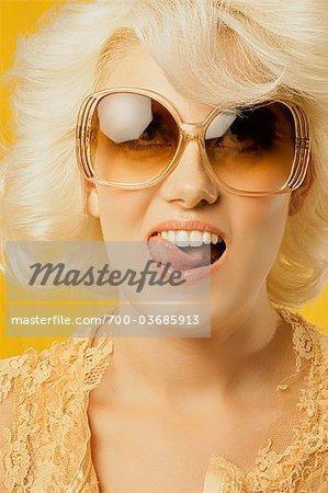 Portrait of Woman Licking Teeth