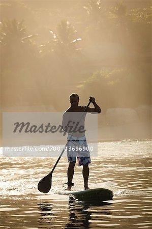 Paddleboard Surfer at Nihiwatu Resort, Sumba, Indonesia