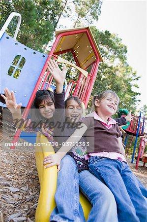 Sisters on Playground Slide