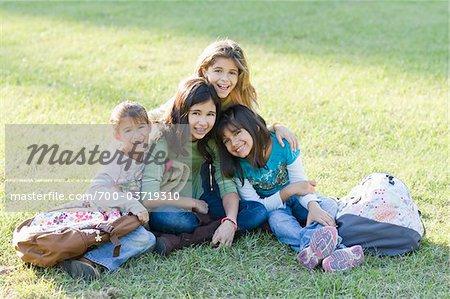 Portrait of Girls Sitting on Grass