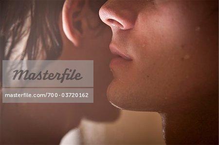 Close-up of One Man Whispering to Another, Taipa, Macau, China