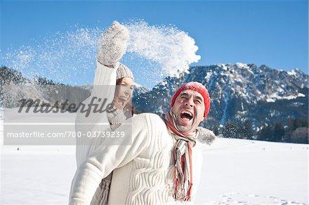 Couple Having Snow Fight