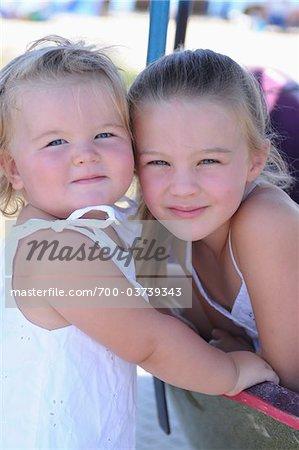 Portrait of Sisters at Amusement Park