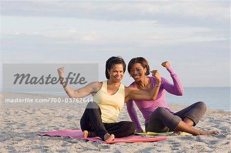 Women Flexing Muscles on Beach