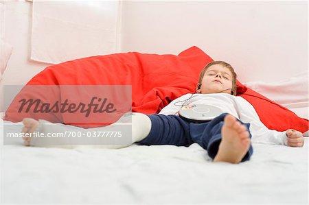 Boy with Broken Leg Wearing Earphones