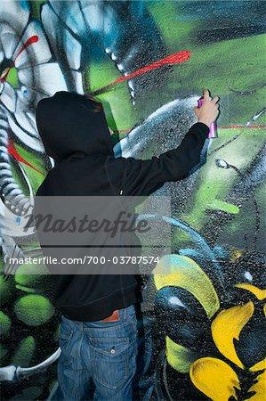 Boy Spray Painting Graffiti